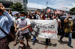 Flower power: Myanmar protesters wear flowers to mark Suu Kyi's birthday