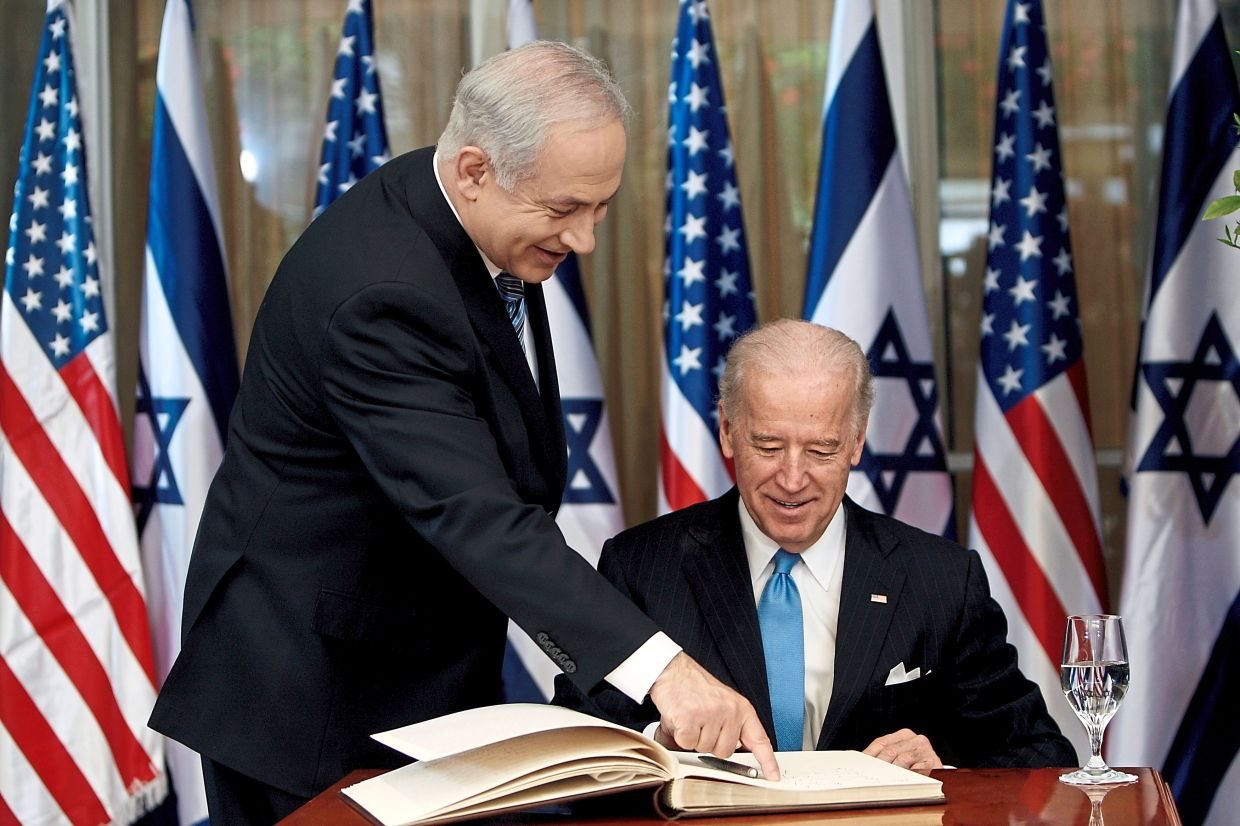 In this 2010 file photo, Biden prepares to sign the guest book before his meeting with Netanyahu at his  residence in Jerusalem. — Reuters
