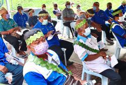 Orang Asli village chiefs get vaccinated to set an example