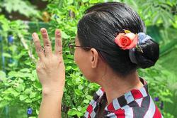 Protesters wear flowers to mark Suu Kyi's birthday
