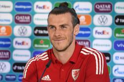 Soccer-Bale dismisses Mancini's Stoke comparison as Wales target Italy upset