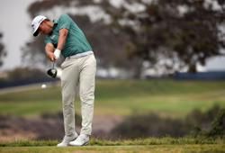 Golf-All but ignored, steady Bezuidenhout sneaks into contention at U.S. Open