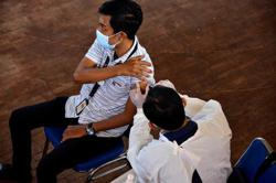 Indonesia reports 13,737 daily coronavirus infections, 371 deaths; highest daily virus spike since late January