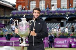 Tennis-Berrettini powers to Queen's title