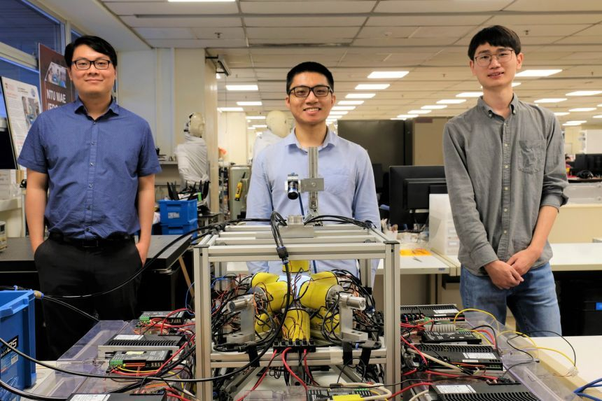 The NTU research team with the electromagnetic coil system that generates the varying magnetic fields control robots. — NTU SINGAPORE