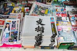 Hong Kong's Apple Daily to decide Monday on shutting down paper