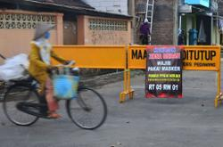All eyes on Jokowi as local leaders scramble to fight surge of Covid-19 in Indonesia