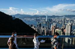 Hong Kong to reduce quarantine for arrivals from Singapore, US