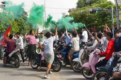 Myanmar's Suu Kyi thanks supporters for flower protests