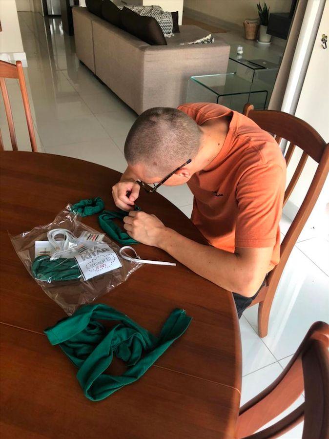 Even the male teachers like Adam Lakhani joined in to help sew scrunchies. Photo: KitaKitar