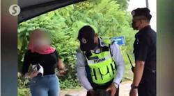 Woman nabbed over roadblock rage incident
