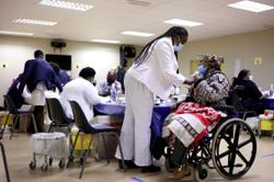 South Africans battle to bridge digital divide in Covid-19 vaccination race
