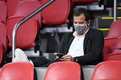Soccer-Spain hit back after Van der Vaart's