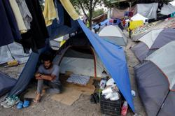 In a Mexican border camp, asylum seekers wait for Biden to end Trump health directive