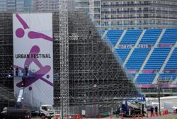 Olympics-Tokyo 2020 organisers ban alcohol, defend allowing spectators