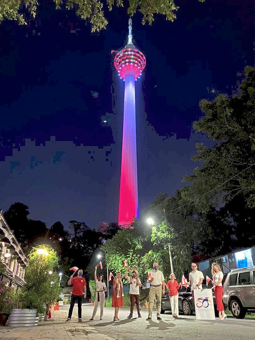 Polish connection: Polish Ambassador Krzysztof Dębnicki (fourth from right) along with embassy staff members gathering to witness the lighting up of KL Tower in Poland's national colours to mark the long-standing ties between the two countries.