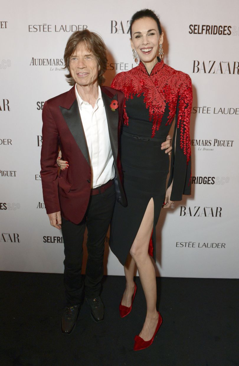 A 2013 file photo showing Mick Jagger and L'Wren Scott at the Harper's Bazaar Women of the Year Awards. Photo: AP