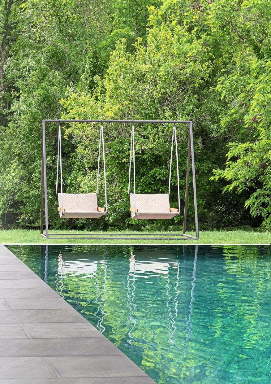 Poolside swings from Ethimo seem to capture a mood that everyone is looking for these days. Photo: Bernard Touillon/Ethimo/dpa