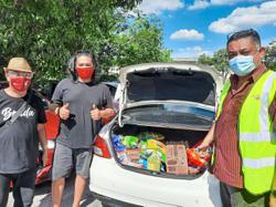 Social enterprise distributes essential foodstuff to group struggling to make ends meet