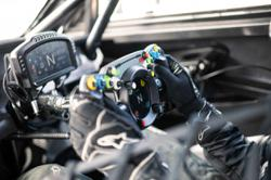 This real race car steering wheel also works with virtual motorsport simulators