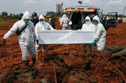 Fourteen hours to collect a corpse in Jakarta as Covid toll mounts