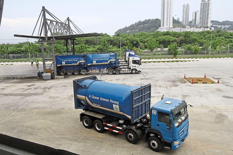 Rubbish trucks at the Batu Maung Waste Transfer Station.