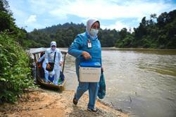 Pharmacists brave the wild to inoculate Orang Asli