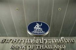 Thai central bank holds rates, cuts GDP outlook on tourism slump