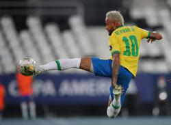 Soccer-Late goal gives Brazil controversial 2-1 win over Colombia