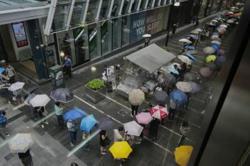 Emotions run high as Hong Kong residents snap up final edition of Apple Daily