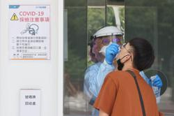Taiwan says discussing COVID-19 vaccine passports