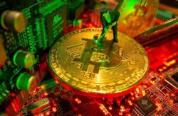 China's crypto-miners look abroad as regulators tighten noose