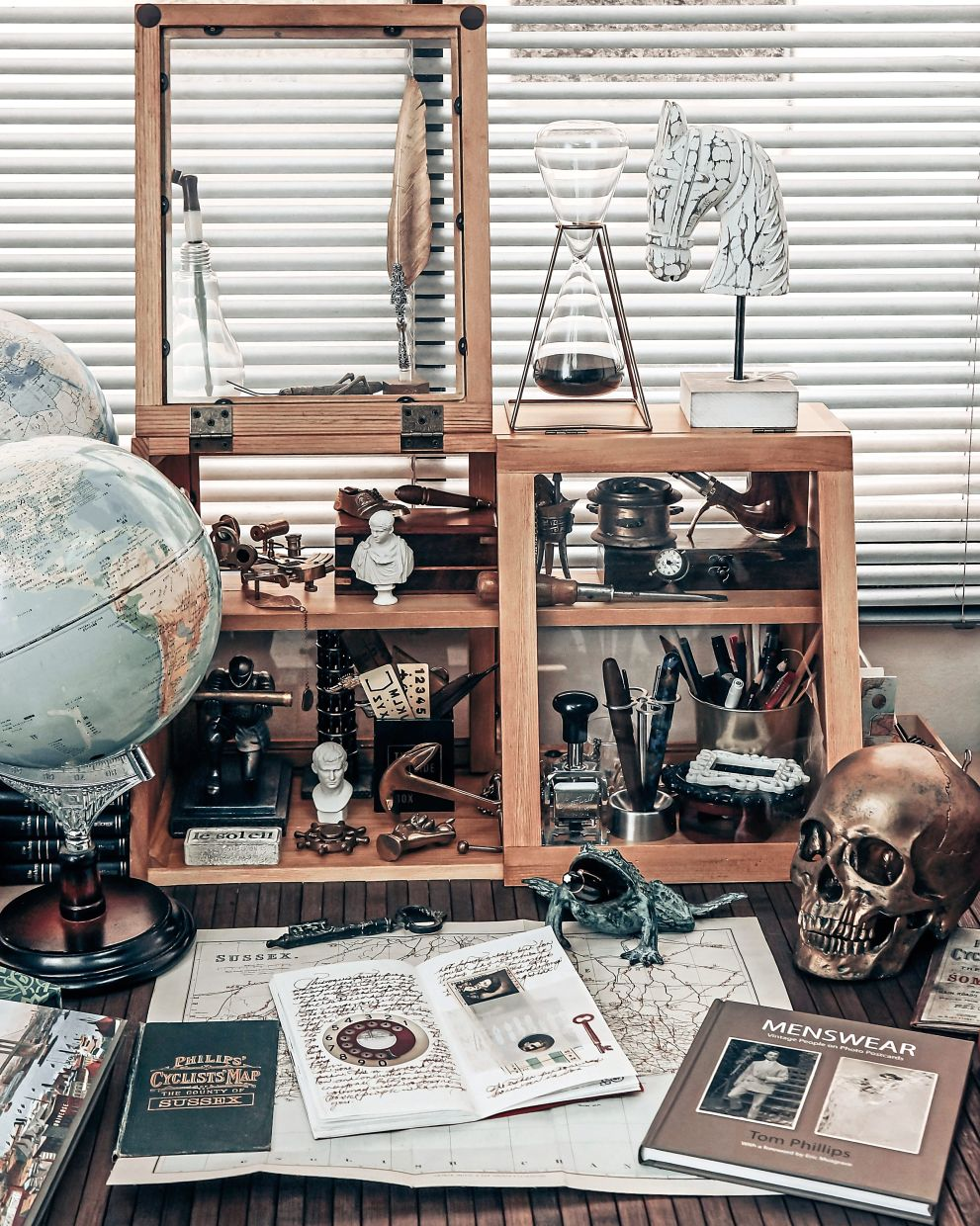 Vintage ornaments, maps and books collected from local flea market and vintage thrift shop are among the items used in Khairul's vintage photography content.