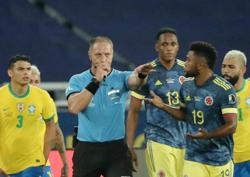 Soccer-Colombia want referee axed after ball hits him before goal