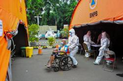 Indonesia converts more hospital beds to treat Covid-19 patients as cases surge