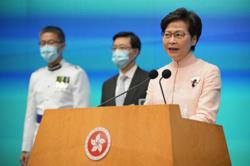 China promotes security officials to senior roles in Hong Kong