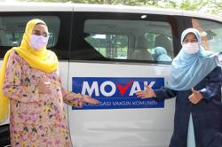 Mobile vaccination centres will boost efforts to inoculate 500,000 traders in Malaysia, says Zuraida