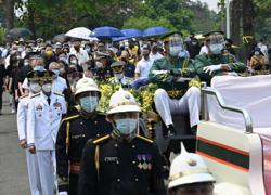 Filipinos bid farewell to former president Benigno Aquino; popular leader laid to rest amid outpouring of grief, tributes