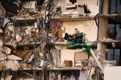 Five dead, 156 still missing in Florida building collapse as searchers race against time
