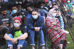 Indonesian Central Java province orders lockdowns as virus spike worsens; Covid-19 total now at 2,135,998