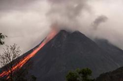 Hot clouds slide down 2km from Indonesian volcano Merapi's summit