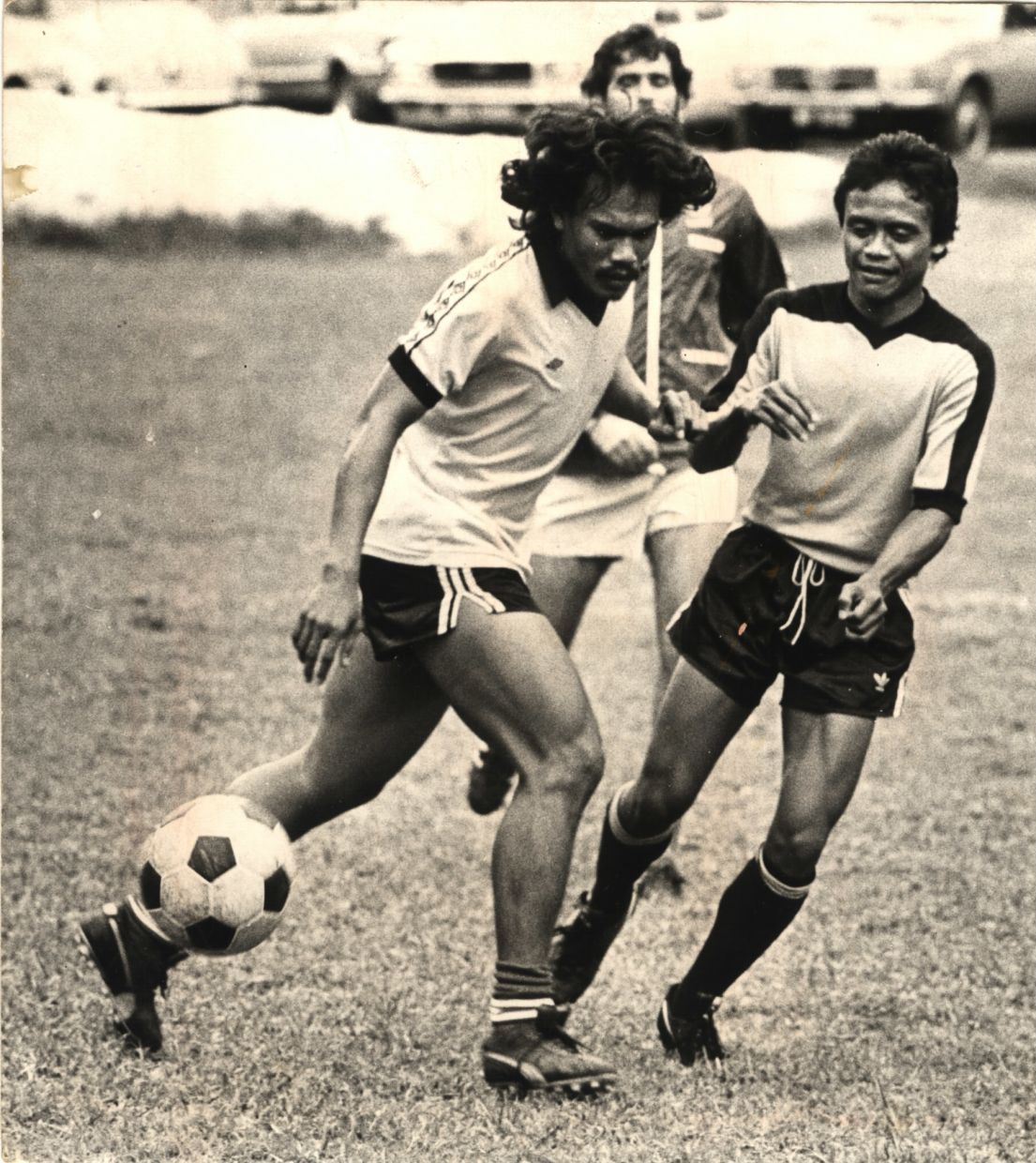 Former Malaysian footballers Mokhtar Dahari (centre) and Reduan Abdullah during training in 1979. – Photo: THE STAR/C.H. L