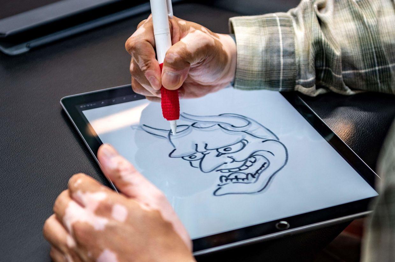 Ichi Hatano drawing a 'hannya' mask digital image at his studio in Tokyo. Photo: AFP