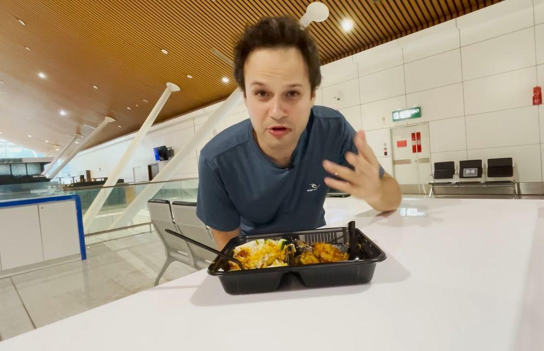James enjoying his last 'ta pao' of nasi lemak at the KLIA.