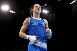 Olympics-Canadian boxer wins battle to compete in Tokyo