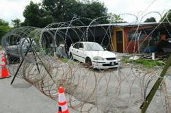 KL police: Barbed wire, road barriers will be used in EMCO areas