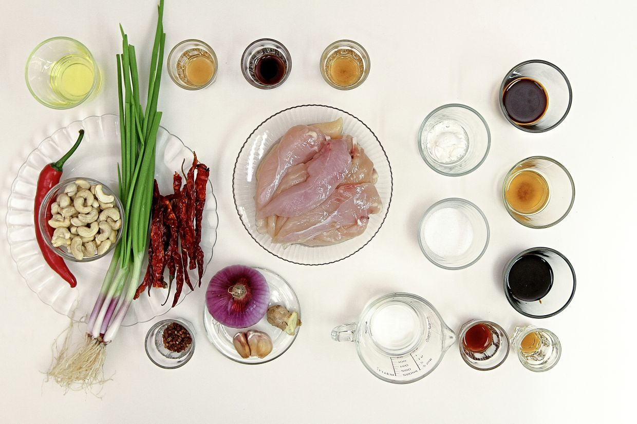Ingredients for the dish include dried chillies, Sichuan peppercorns and black vinegar. — Photos: YAP CHEE HONG/The Star