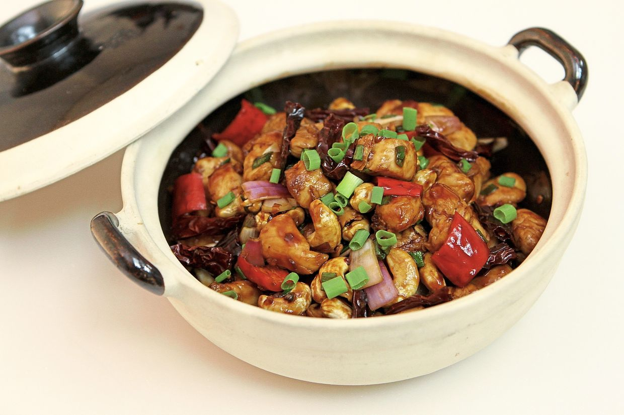 The classic 'kung pao' chicken is sweet and spicy with a hint of Sichuan peppercorns and black vinegar.