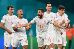 Soccer-Spain conquer penalty demons to reach semis against gallant Swiss