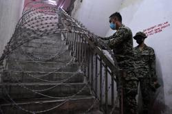Barbed wire on staircase received Bomba approval, say police
